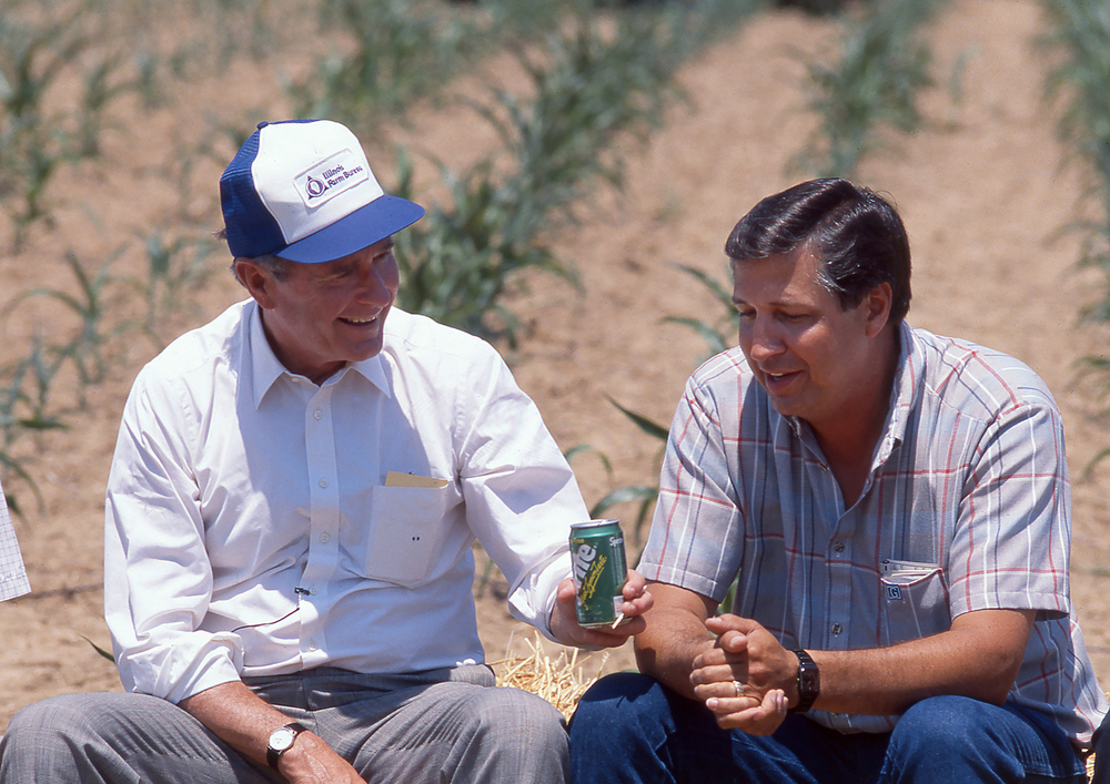 Vice President George H. W. Bush talks with Raymond Poe June 18, 1988 in a corn field near Sherman. Bush was touring Poe's drought stricken corn field during a campaign stop in the area. File/The State Journal-Register