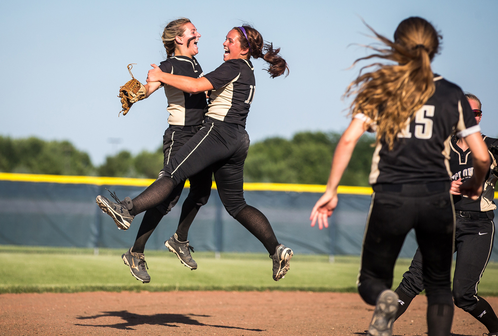 Sacred Heart-Griffin's Katie McLean, left, leaps up into pitcher Whitney David after the Cyclones defeated Highland 7-3 in the Class 3A Springfield Supersectional at the Land of Lincoln Junior Olympic Softball Complex at UIS, Tuesday, June 9, 2015, in Springfield, Ill. Justin L. Fowler/The State Journal-Register