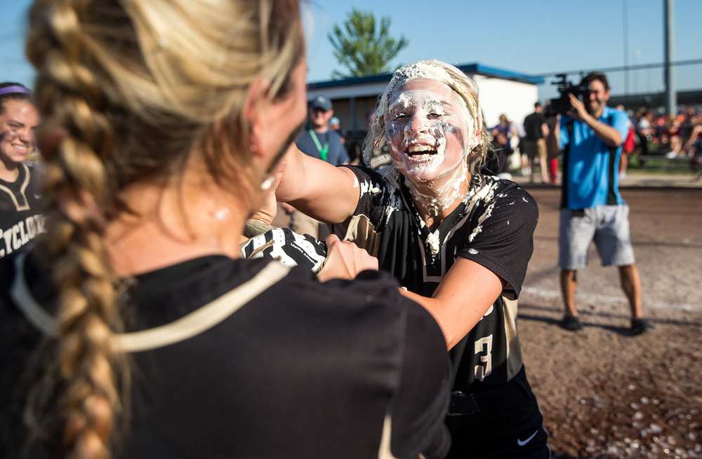 Sacred Heart-Griffin's Mackenzie Trees chases down Katie McLean after getting pied in the face as the Cyclones celebrate their 7-3 victory over Highland in the Class 3A Springfield Supersectional at the Land of Lincoln Junior Olympic Softball Complex at UIS, Tuesday, June 9, 2015, in Springfield, Ill. Justin L. Fowler/The State Journal-Register