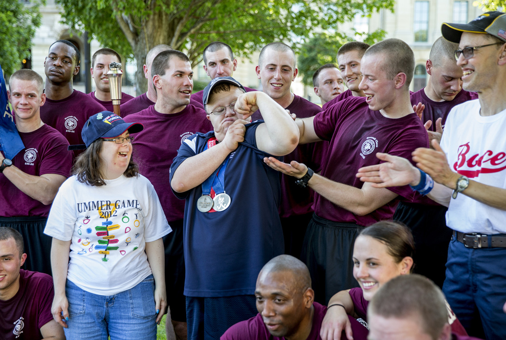 Special Olympics Illinois athlete Aaron Strubbe, center, shows off his muscles in front of the recruit class of the Illinois State Police Academy after they finished the Springfield leg of the Illinois Special Olympics Law Enforcement Torch Run in front of the Illinois State Capitol, Wednesday, June 10, 2015, in Springfield, Ill. Justin L. Fowler/The State Journal-Register