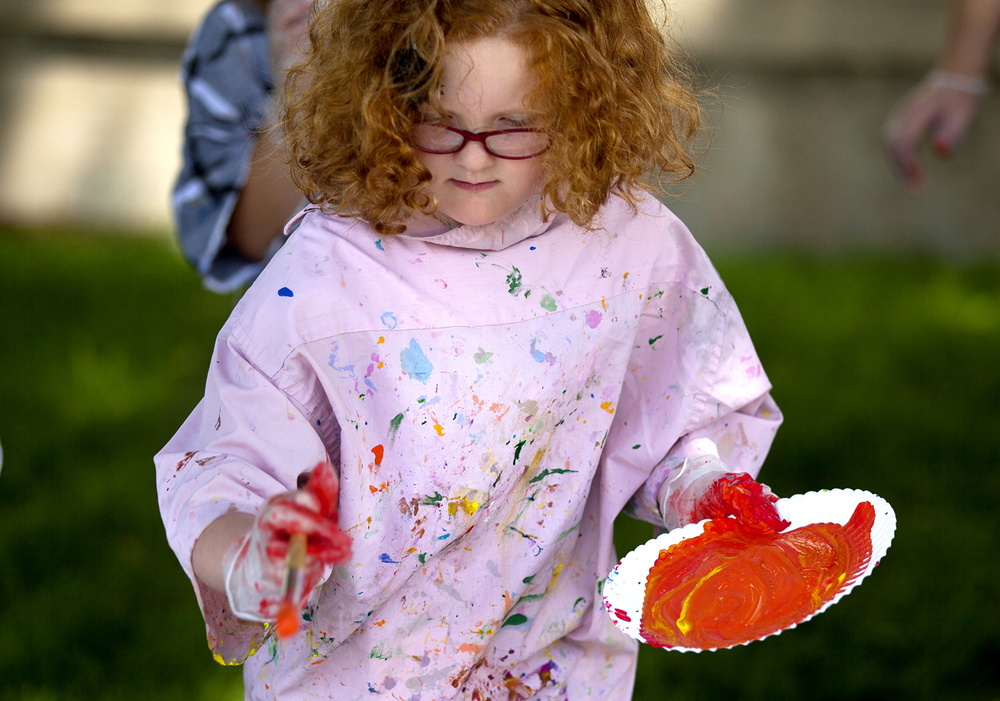 Ella Peach, 5, flings paint from her brush to a large canvas during an art exercise in the style of abstract impressionist artist, Jackson Pollack, Monday, June 8, 2015 at the Illinois State Museum. Peach was participating in the Sticky Icky Ooey Gooey Summer Camp at the museum, which let kids make a mess while exploring art and science. Rich Saal/The State Journal-Register