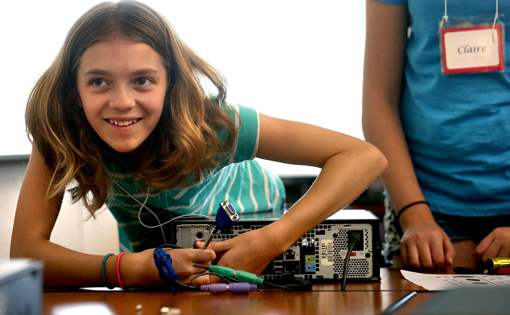 Mackenzie Hostetler, 11 of Athens goes to work reassembling a computer after taking it apart on Thursday morning at University Hall. Girl Tech 2015, a two-day technology immersion program for 56 middle-school aged girls from throughout Central Illinois sponsored by the Computer Science department at the University of Illinois Springfield kicked off on campus on Thursday June 11, 2015. Highlights this year include workshops comparing human DNA to that of a strawberry, creative drawing using 3D pens, creating computer games and disassembling and reassembling a computer box. Girl tech continues Friday.   David Spencer/The State Journal-Register