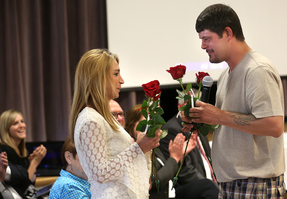 As part of the ceremony, Donnie Runyon of Taylorville finishes handing a rose to Tammy Harris, clinical supervisor at Liberty Counseling in Taylorville who helped him through the program. Graduates each handed out three roses to important people in their lives who helped them complete the program. The third Christian County Drug Court graduation ceremony took place at Taylorville Memorial Hospital Auditorium on Friday, June 12, 2015. Four graduates: Tricia Cox, Chad Johnson, Dennis Boshell and Donnie Runyon received certificates after completing a 24-month program in which they were able to stay out of prison and build a new, drug-free life. David Spencer/The State Journal-Register