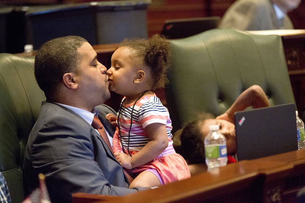 Rep. John Anthony, R-Morris, gets a kiss from his daughter, Kylie, 2, during debate on a property tax relief bill Tuesday, June 9, 2015 at the Capitol in Springfield, Ill. Anthony and several other lawmakers had their children with them during the one day session. Rich Saal/The State Journal-Register