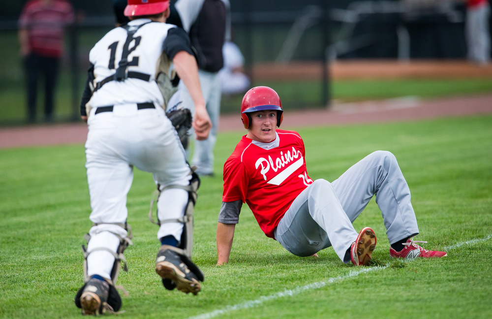 Pleasant Plains' Dylan Bee falls as he gets caught in a rundown by Sacred Heart-Griffin's Sean Mason for the out in the 3rd inning during The Baseball Classic all-star game at Lincoln Land Community College's Claude Kracik Field, Tuesday, June 16, 2015, in Springfield, Ill. Justin L. Fowler/The State Journal-Register