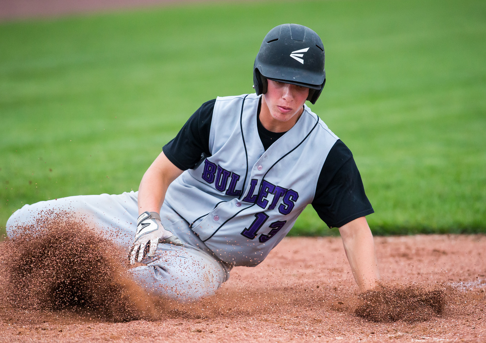 Williamsville's Talon File slides into home plate scoring a  run against the CS8 team in the 3rd inning during The Baseball Classic all-star game at Lincoln Land Community College's Claude Kracik Field, Tuesday, June 16, 2015, in Springfield, Ill. Justin L. Fowler/The State Journal-Register