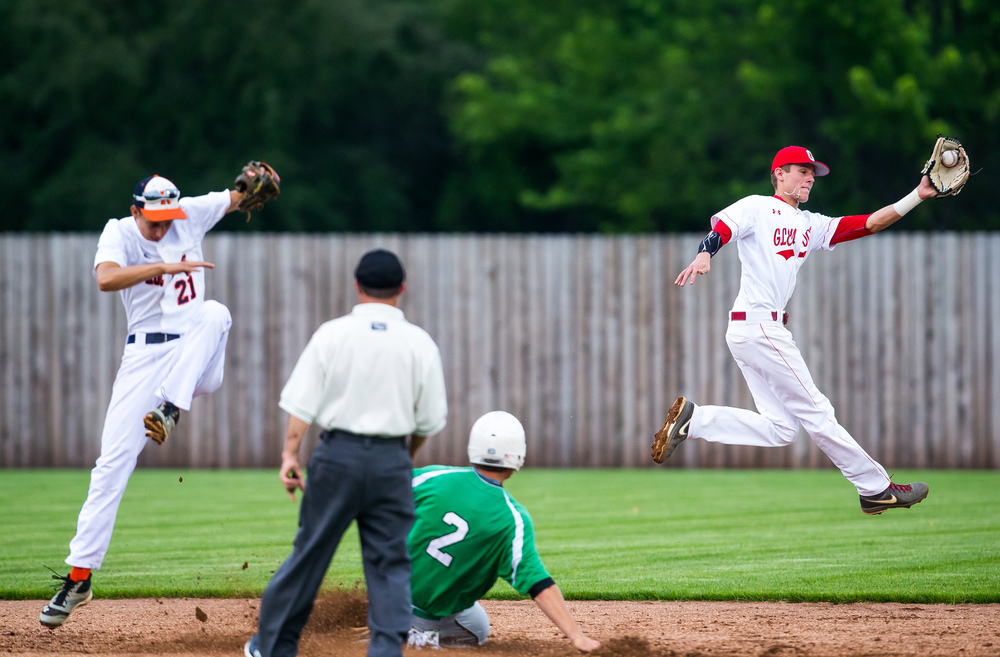 Athens' Dalton Fletcher steals second base as Glenwood's Nick Maton backs up Rochester's Howard Fisher on the throw during The Baseball Classic all-star game at Lincoln Land Community College's Claude Kracik Field, Tuesday, June 16, 2015, in Springfield, Ill. Justin L. Fowler/The State Journal-Register