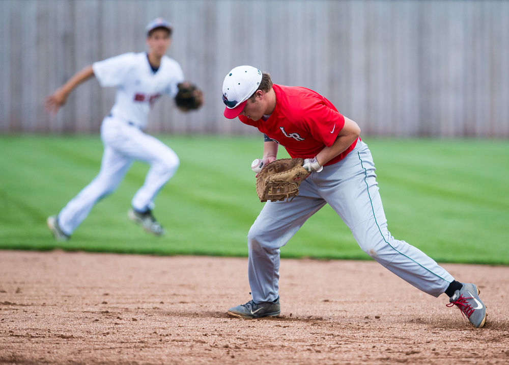 Lincoln's Jordan Yarcho stops a a ground ball from the All Area team during The Baseball Classic all-star game at Lincoln Land Community College's Claude Kracik Field, Tuesday, June 16, 2015, in Springfield, Ill. Justin L. Fowler/The State Journal-Register