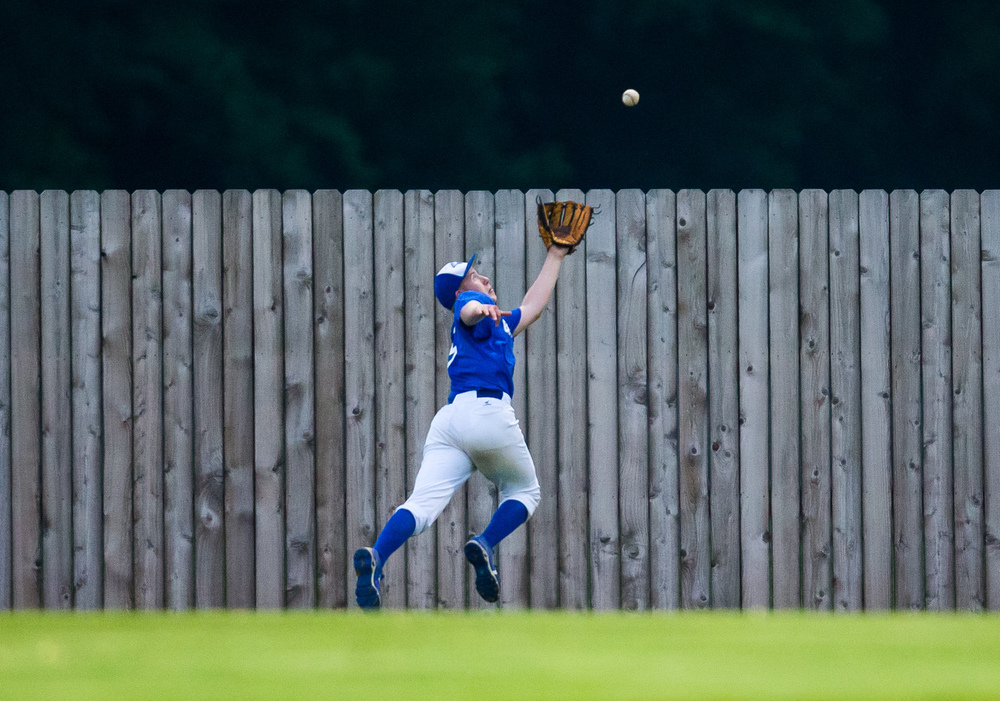 PORTA's Mike McCurdy tries to make a catch in center field against the CS8 team in the 9th inning during The Baseball Classic all-star game at Lincoln Land Community College's Claude Kracik Field, Tuesday, June 16, 2015, in Springfield, Ill. Justin L. Fowler/The State Journal-Register