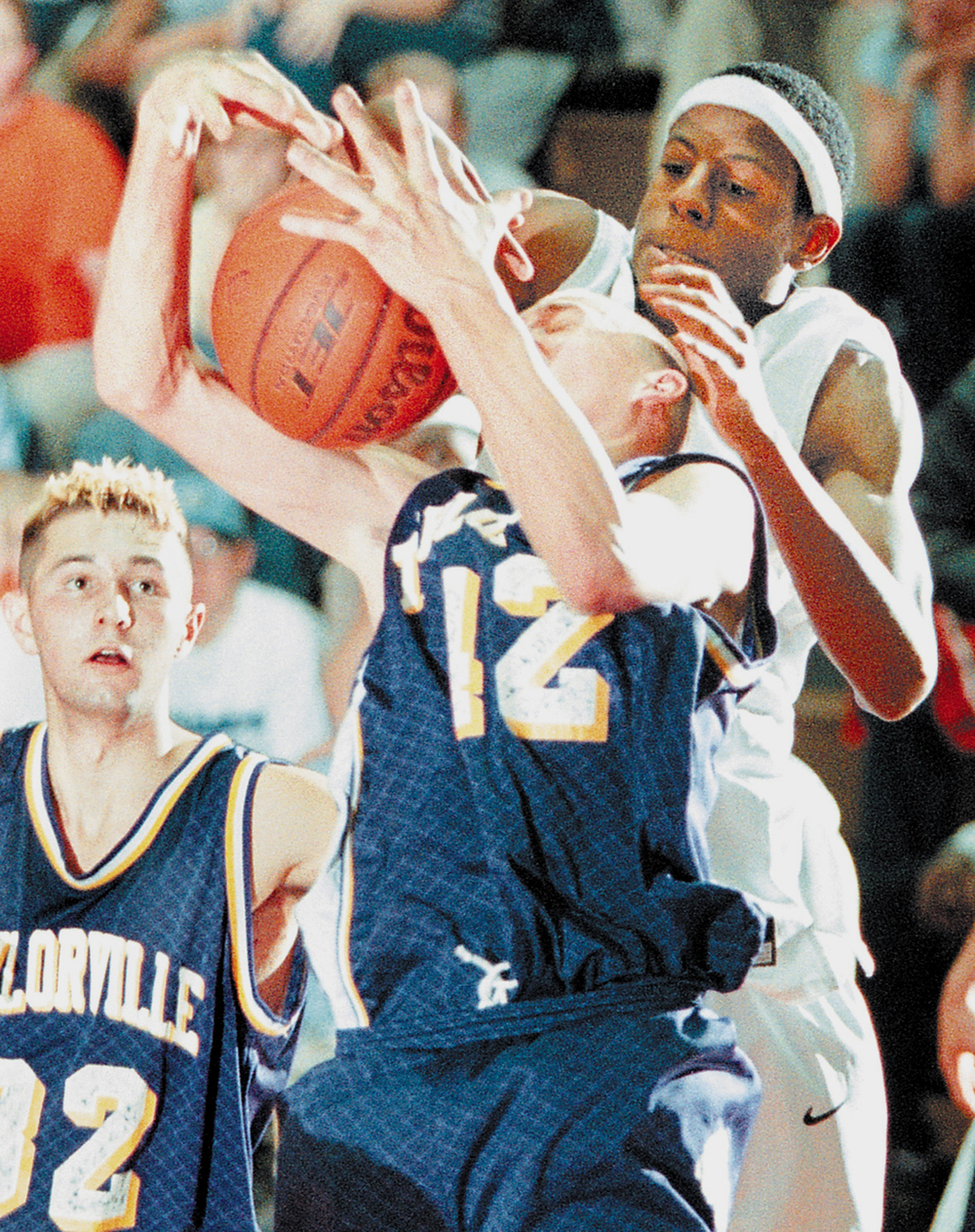 Lanphier's Andre Iguodala reaches over Taylorville's Zach Hennings' head to block his shot during their game at Lanphier High on Friday, Jan. 12, 2001. File/The State Journal-Register