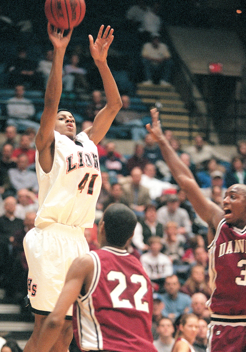 Lanphier High School's Andre Iguodala shoots over Danville defenders during the IHSA Class AA Sectional tournament, March 2001. File/The State Journal-Register