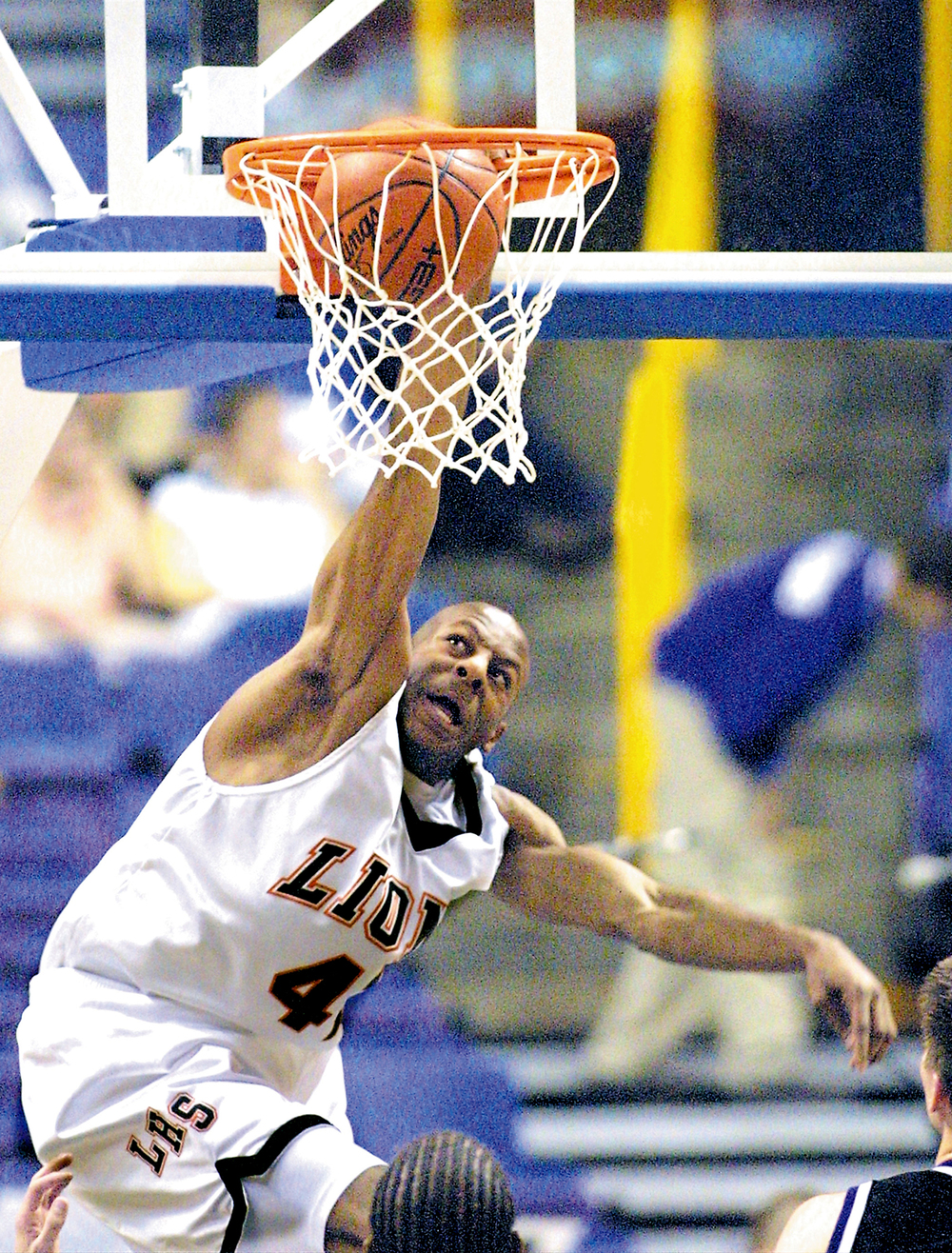Andre Iguodala slams home one of his four dunks against Broughton High School at the Shop'n Save KMOX Shootout at the Savvis Center in St. Louis Dec. 7, 2001. Ted Schurter/The State Journal-Register.8BIM