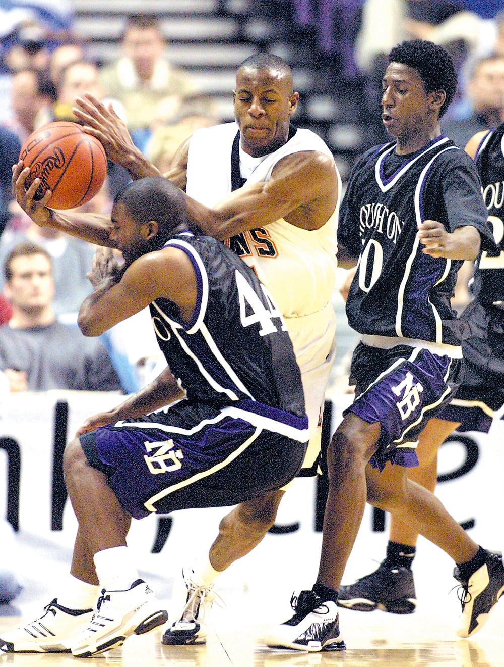 Lanphier's Andre Iguodala crashes into Broughton'w Mike Roper, 44, as Jamaal Eatmon closes in during the Shop'n Save KMOX Shootout at the Savvis Center in St. Louis Dec. 7, 2001. Ted Schurter/The State Journal-Register