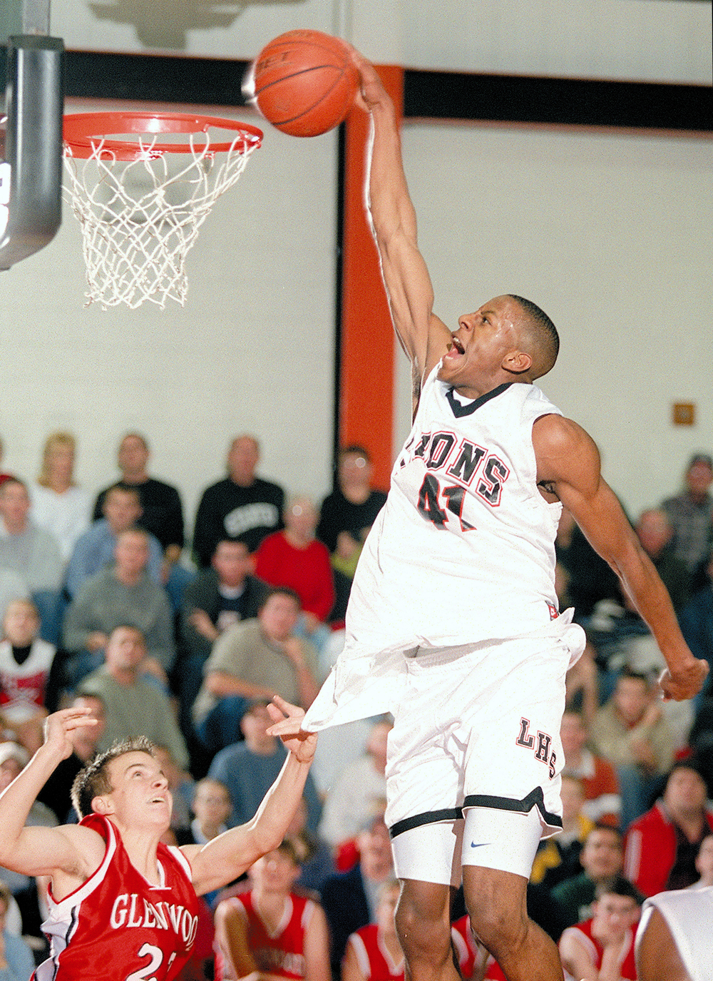 Lanphier's Andre Iguodala flies down the lane with a thunderous dunk during the first half of action against the Glenwood Titans, Jan 11, 2002. File/The State Journal-Register