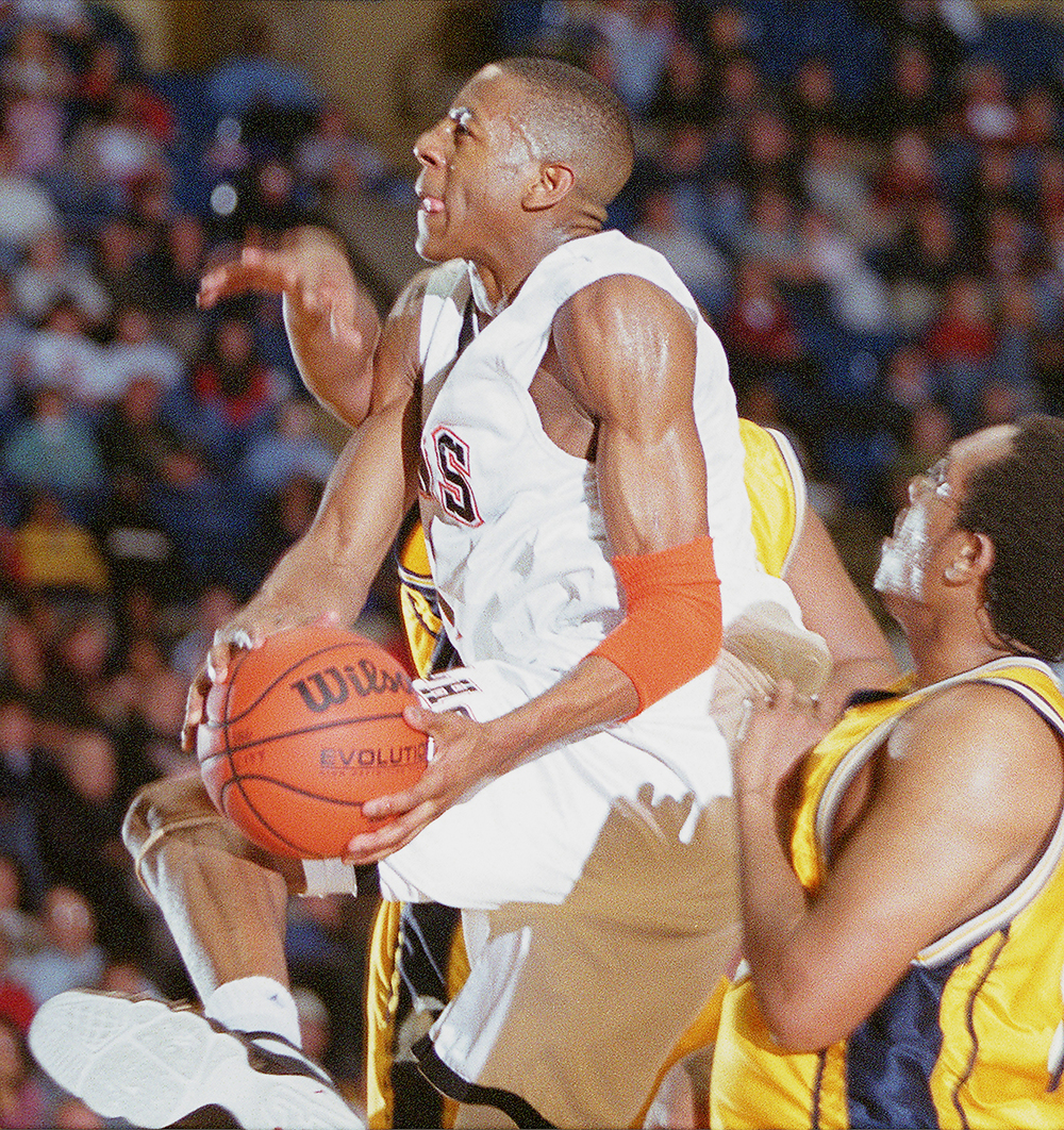 Andre Iguodala tries to power his way through a stubborn Southeast High defense Jan. 17, 2002. File/The State Journal-Register