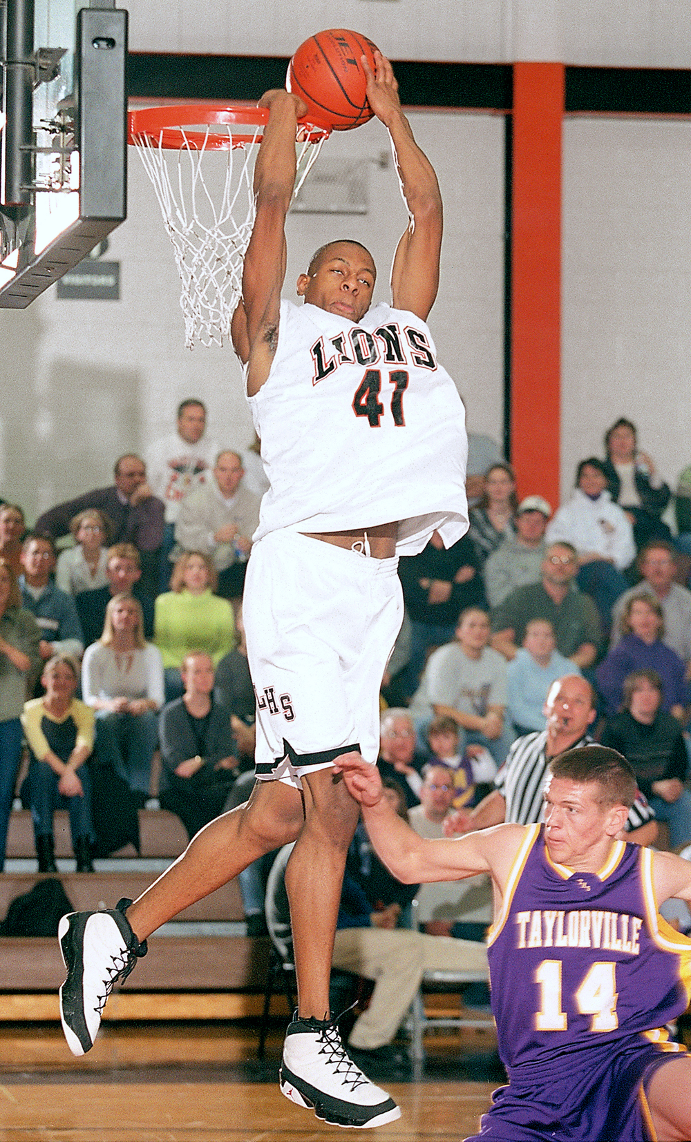 Andre Iguodala couldn't get this dunk to go down, but that was about the only thing that went wrong for Lanphier during a game with Taylorville, Feb. 1, 2002. File/The State Journal-Register