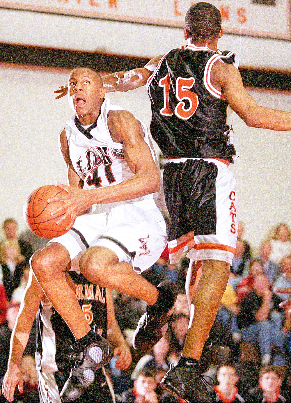 Lanphier's Andre Iguodala goes right past the Normal West defense at Lanphier High School Feb. 5, 2002. File/The State Journal-Register