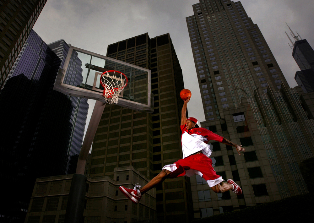 Andre Iguodala soars towards the hoop on a rooftop court at his Presidential Towers apartment complex in Chicago June 22, 2004. The  photo was made for a story about Iguodala, a 2002 Lanphier graduate, before 2004 NBA draft. File/The State Journal-Register