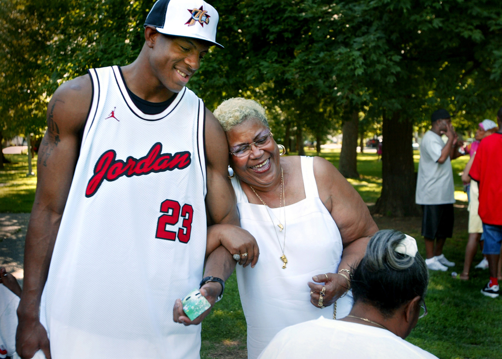 Wajeedah Rahim, a family friend, has a tight hold on Andre Iguodala's arm as they visit with family during a welcome home party July 9, 2004 at Iles Park. Iguodala was celebrating his ninth pick by the Philadelphia 76ers in the 2004 NBA Draft. File/The State Journal-Register