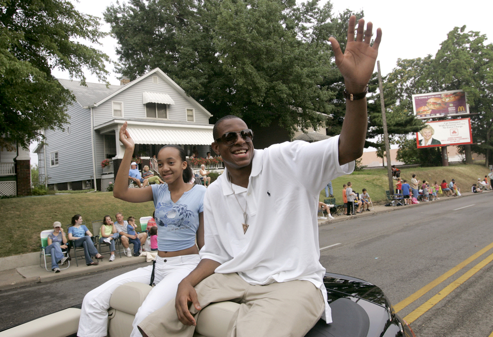 Andre Iguodala waves to fans on Ninth Street while helping kick off the Illinois State Fair as the Grand Marshall of the Twilight Parade Aug. 12, 20005. Riding with  Iguodala is his cousin Aliyyah Nailing of Springfield. File/The State Journal-Register