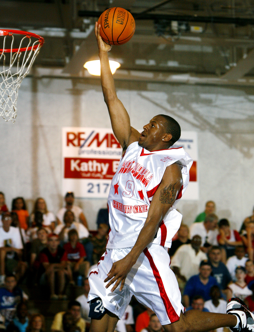 Andre Iguodala drives to the hoop during the 2nd annual Andre Iguodala Celebrity Basketball Game at Lincoln Land Community College June 24, 2006. Ted Schurter/The State Journal-Register