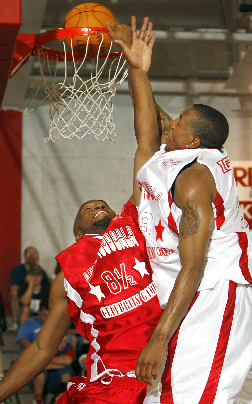 Andre Iguodala dunks over the player known as Big Head during the second annual Andre Iguodala Celebrity Basketball Game at Lincoln Land Community College June 24, 2006. Ted Schurter/The State Journal-Register