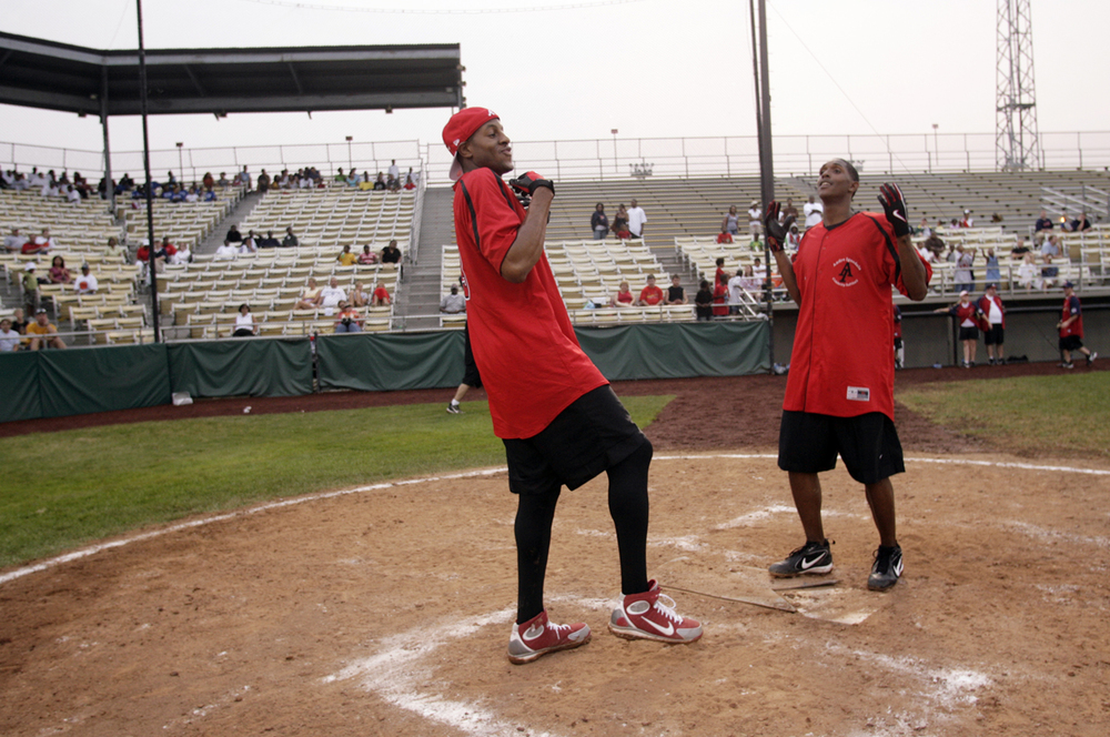 Andre Iguodala celebrates a homerun by dancing with Philadelphia 76ers teammate Louis Williams during Andre Iguodala Celebrity All Star Softball Game Sat. August 4, 2007 at Lanphier Park. Ted Schurter/The State Journal-Register