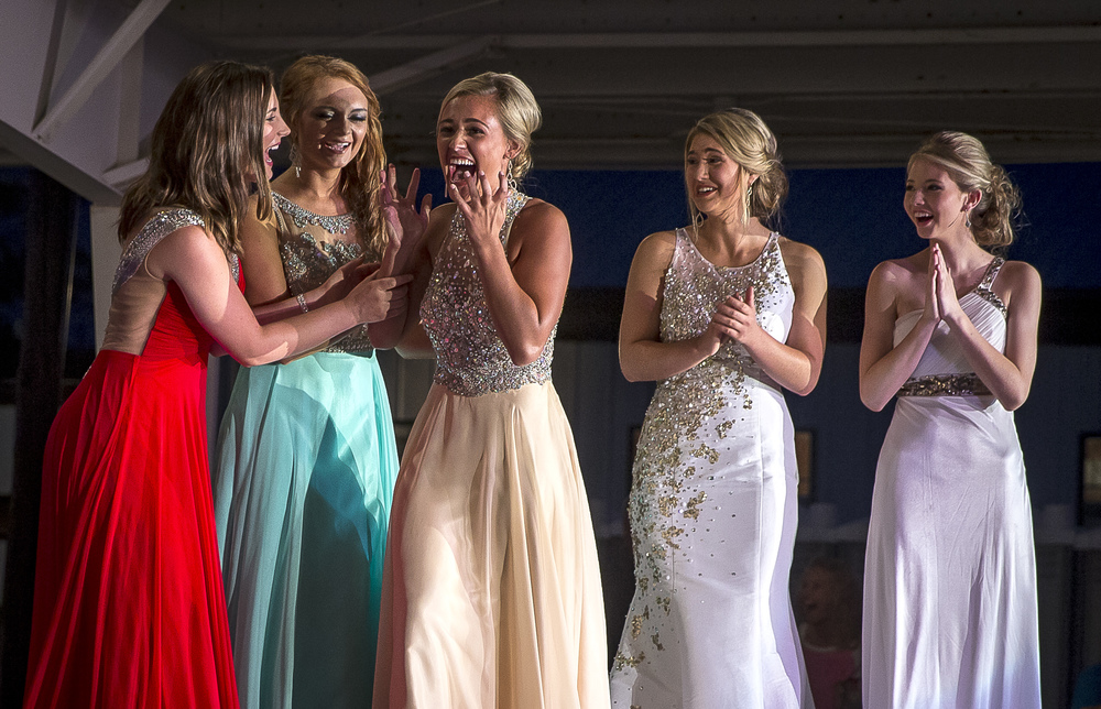 Megan Urbas, center, reacts after being named Miss Sangamon County Fair Queen 2015 during the 57th Annual Sangamon County Fair Queen Pageant at the Sangamon County Fairgrounds, Wednesday, June 17, 2015, in New Berlin, Ill. Justin L. Fowler/The State Journal-Register