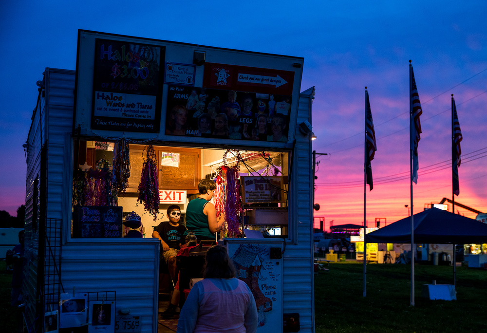 The face painting was still going as the sun sets over the Sangamon County Fairgrounds, Wednesday, June 17, 2015, in New Berlin, Ill. Justin L. Fowler/The State Journal-Register