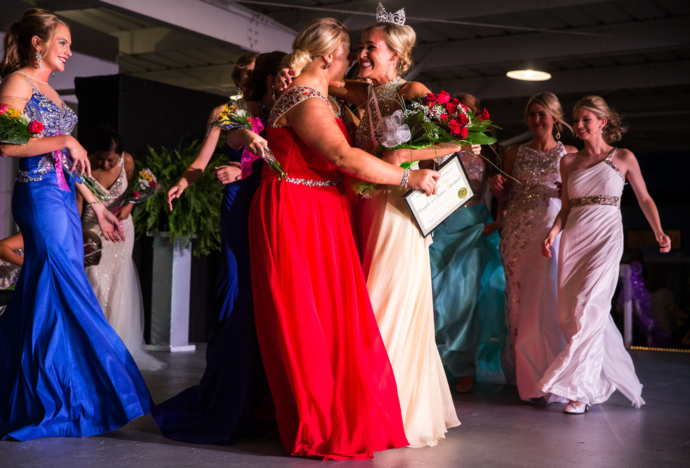 Megan Urbas, center, celebrates with Bella Parnell, left, after being named Miss Sangamon County Fair Queen 2015 during the 57th Annual Sangamon County Fair Queen Pageant at the Sangamon County Fairgrounds, Wednesday, June 17, 2015, in New Berlin, Ill. Justin L. Fowler/The State Journal-Register