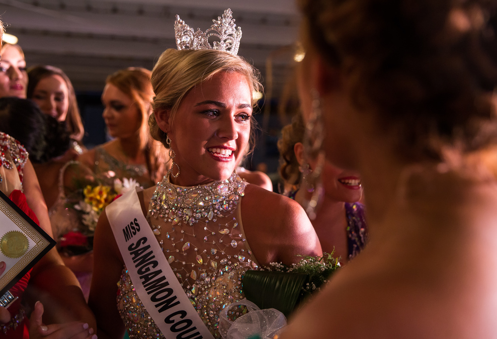 Megan Urbas, center, celebrates with her fellow contestants after being named Miss Sangamon County Fair Queen 2015 during the 57th Annual Sangamon County Fair Queen Pageant at the Sangamon County Fairgrounds, Wednesday, June 17, 2015, in New Berlin, Ill. Justin L. Fowler/The State Journal-Register