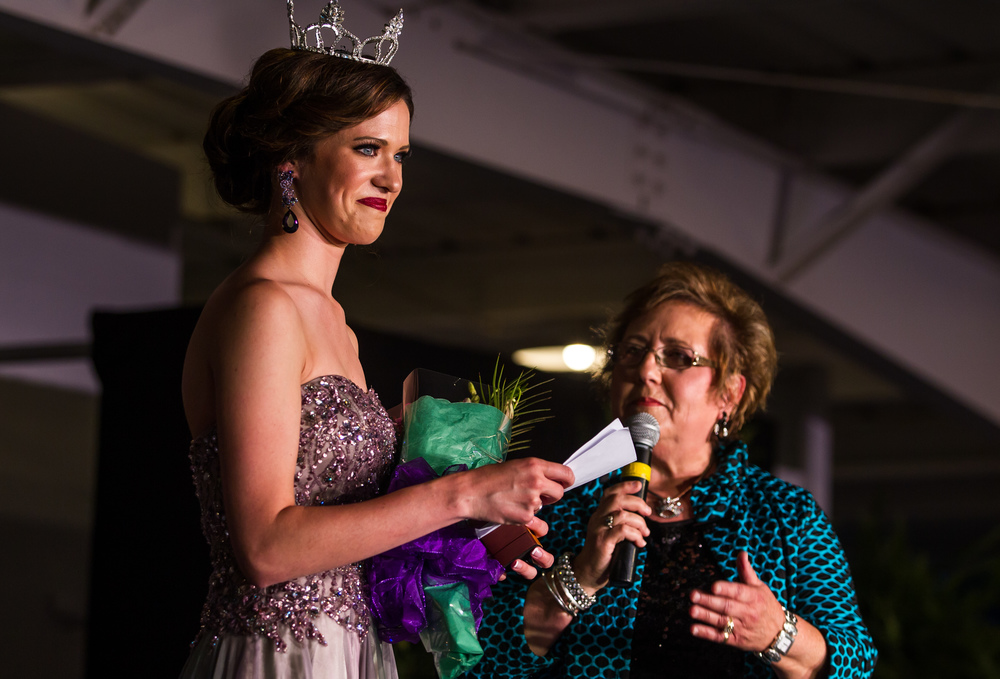 Anna Washko, Miss Sangamon County Fair Queen 2014, receives a bouquet of flowers prior to her farewell from pageant director Suzanne Cowman during the 57th Annual Sangamon County Fair Queen Pageant at the Sangamon County Fairgrounds, Wednesday, June 17, 2015, in New Berlin, Ill. Justin L. Fowler/The State Journal-Register