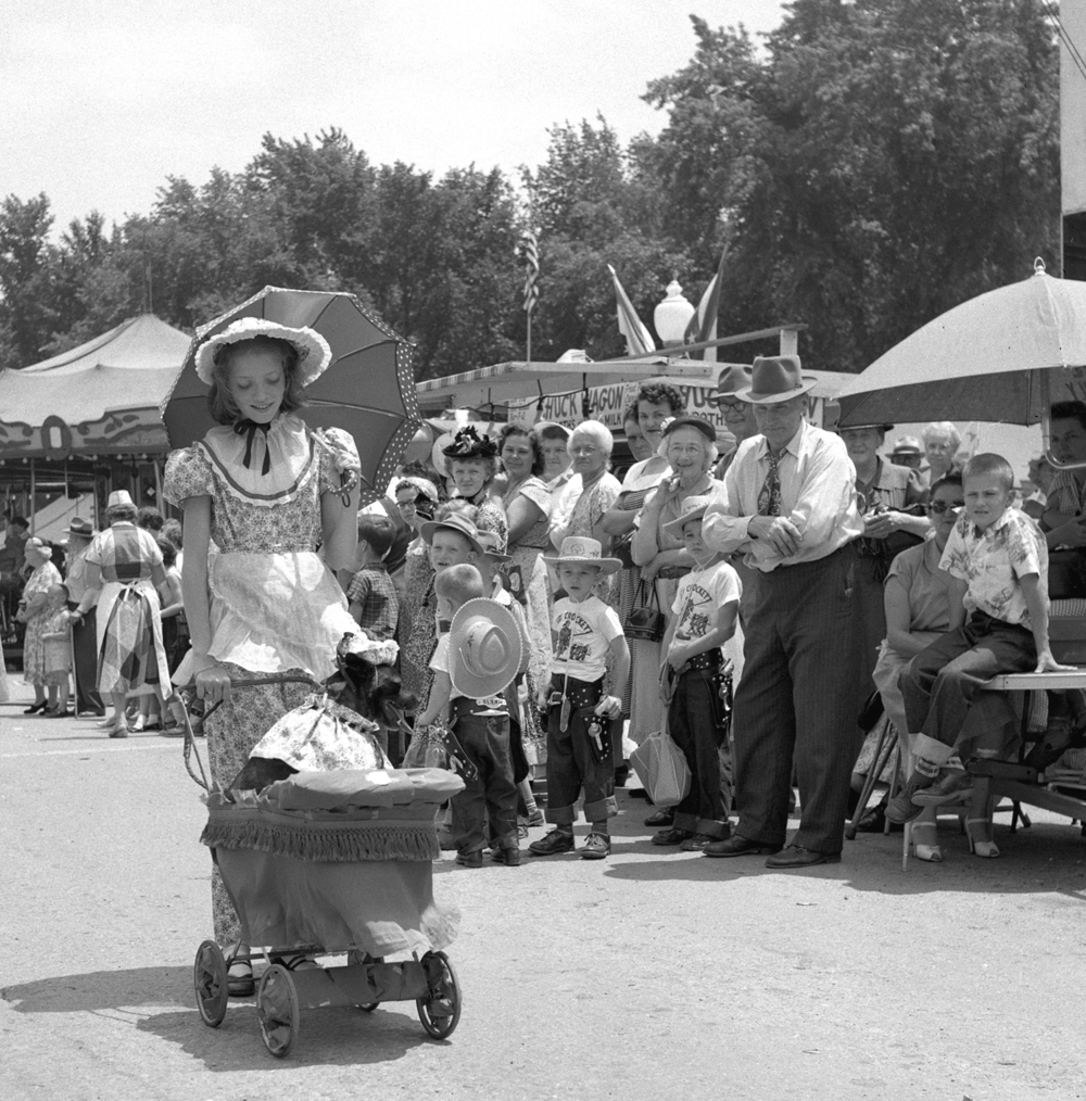 Carlene Trimble, 11, and her dog, Mollie, who rode in a baby stroller, both were dressed in period clothing for the Girard Centennial Pioneer Days parade June 17, 1955 in Girard, Ill. File/TheState Journal-Register