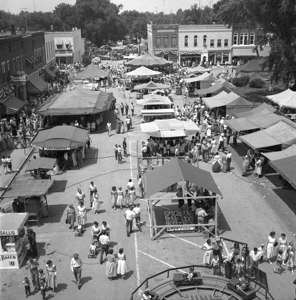 The carnival took up three full blocks around the square at the Girard Centennial Pioneer Days celebration and parade June 17, 1955 in Girard, Ill. File/TheState Journal-Register