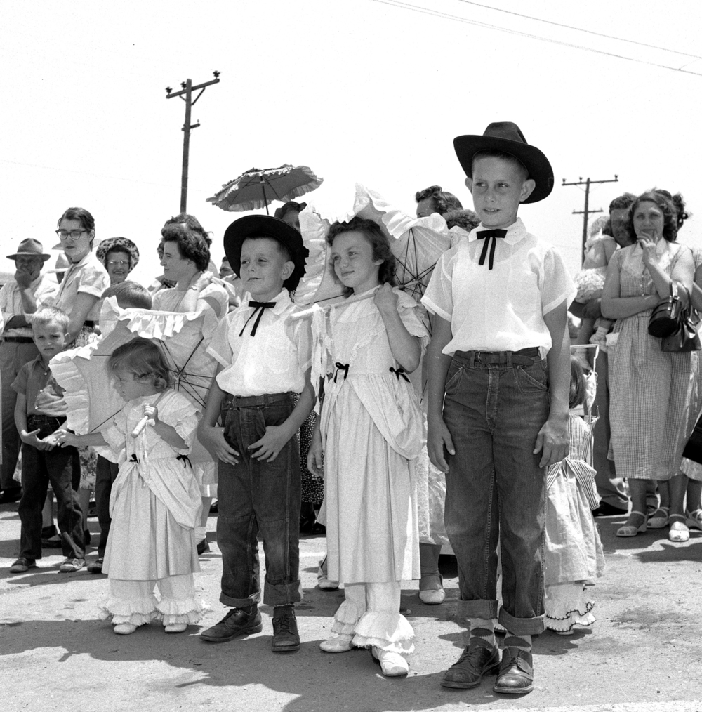 Vicki Jennings, 3, left,  Bobby Pitchford, 7, Sherry Jennings, 8 and Dickie Pitchford, 9, watch the Girard Centennial Pioneer Days parade June 17, 1955 in Girard, Ill. File/TheState Journal-Register