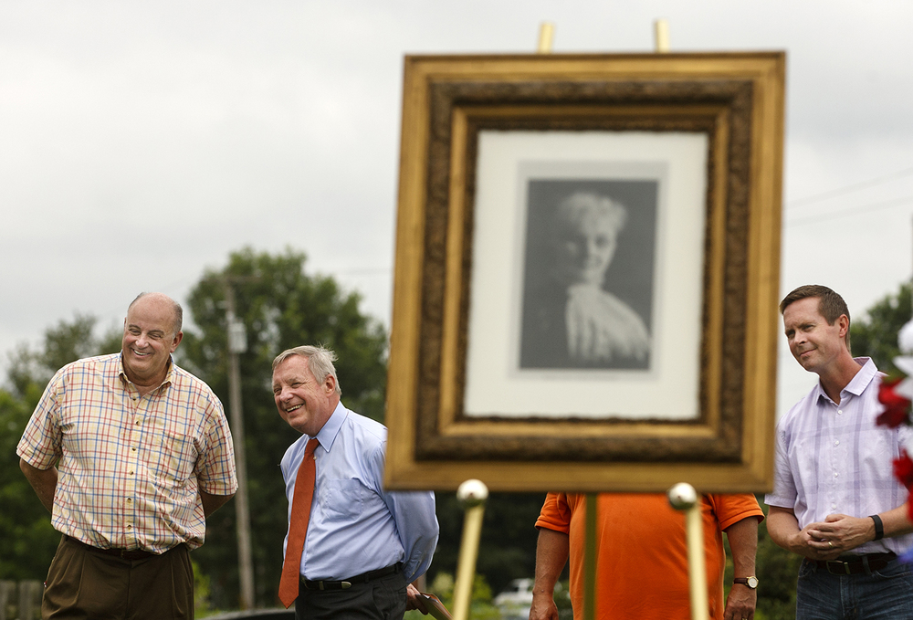 Michael Carrigan, president of the Illinois AFL-CIO, laughs with U.S. Senator Dick Durbin, D-Ill. during a rededication ceremony for the Mother Jones Monument at Union Miners' Cemetery in Mt. Olive Saturday, June 20, 2015. Congressman Rodney Davis, R-Taylorville, is at right. Ted Schurter/The State Journal-Register