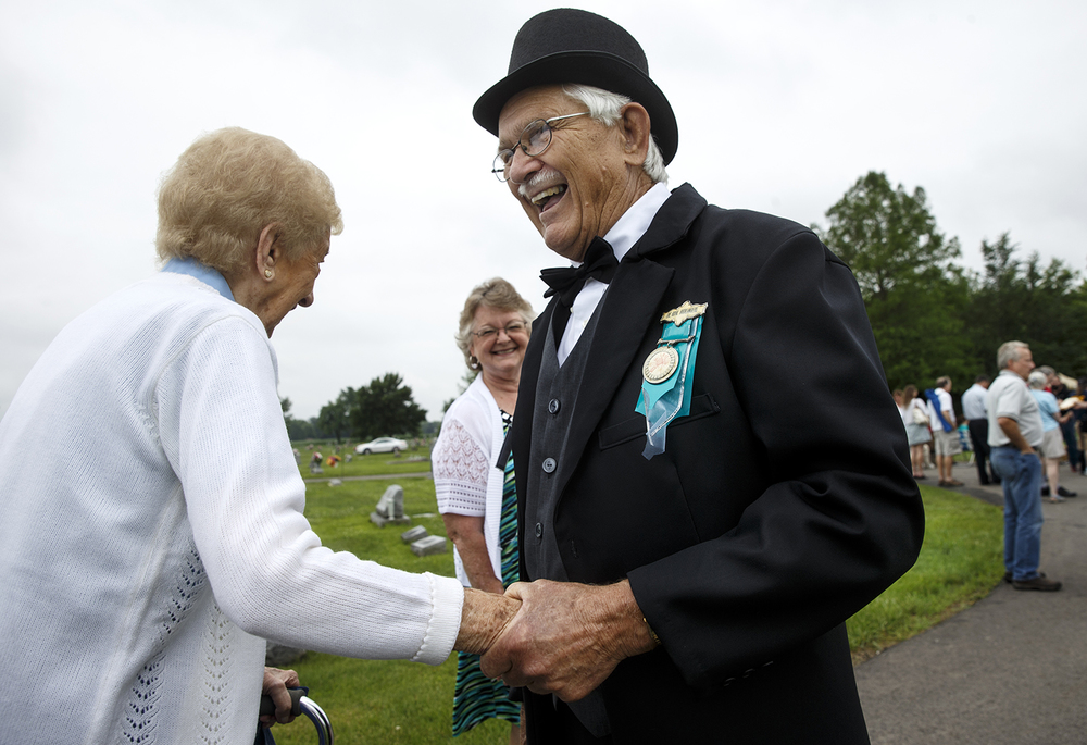 "Jim Alderson, portraying ""General Alexander Bradley"" greets guests at the rededication ceremony for the Mother Jones Monument at Union Miners' Cemetery in Mt. Olive Saturday, June 20, 2015. Bradley was a union activist and organizer buried at the cemetery. Ted Schurter/The State Journal-Register"