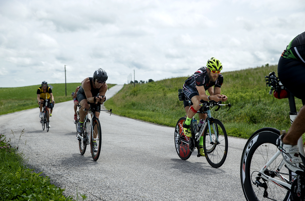 James Lawrence pedals toward Cass County as he works toward completing his daily Ironman Triathlon miles Sunday, June 21, 2015. Lawrence is on a quest to complete 50 Ironman courses in 50 consecutive days through all 50 States.  Ted Schurter/The State Journal-Register