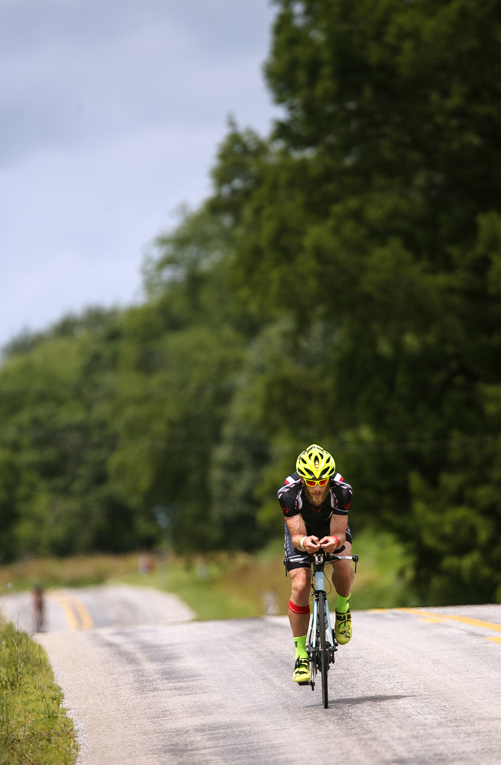 James Lawrence pedals back toward Menard County as he works toward completing his daily Ironman Triathlon miles Sunday, June 21, 2015. Lawrence is on a quest to complete 50 Ironman courses in 50 consecutive days through all 50 States. Ted Schurter/The State Journal-Register
