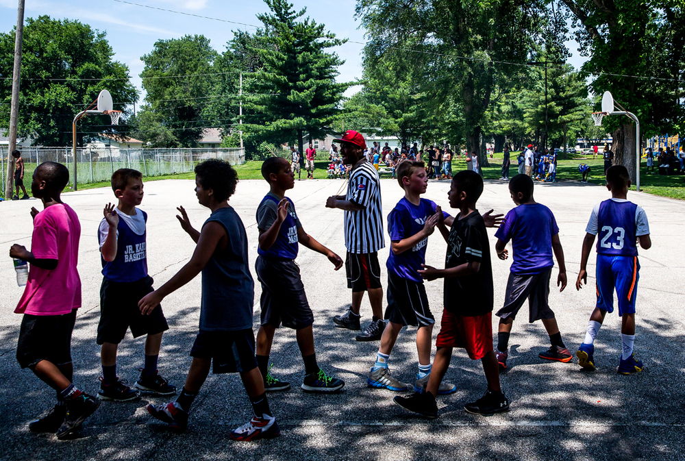 Teams shake hands after completing a game in the 5 on 5 basketball tournament during the 22nd annual Juneteenth Celebration at Comer Cox Park, Saturday, June 20, 2015, in Springfield, Ill. Justin L. Fowler/The State Journal-Register
