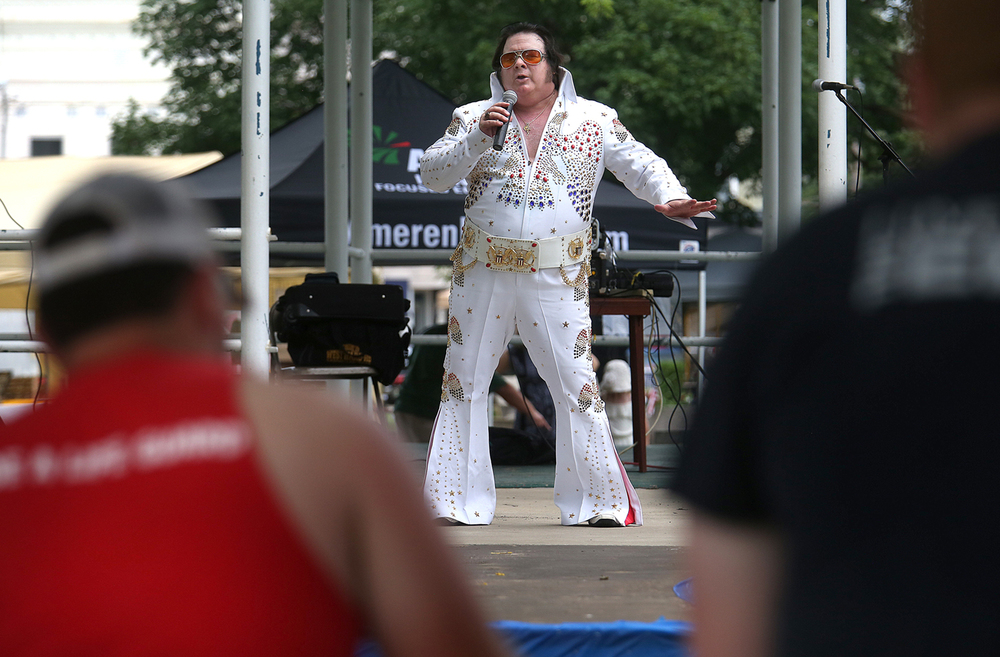 Elvis Himselvis: aka Rick Dunham of Springfield, performed Sunday afternoon on the Virden town square as part of the festival. The Virden Blue Carpet Festival, part of the first annual Illinois Route 66 Blue Carpet Corridor weekend festival, concluded a two-day run on the Virden town square on Sunday, June 14, 2015. The Blue Carpet Corridor, from Chatham south to Collinsville, is a section of the Mother Road rich in mining history as well as mobster lore. David Spencer/The State Journal-Register