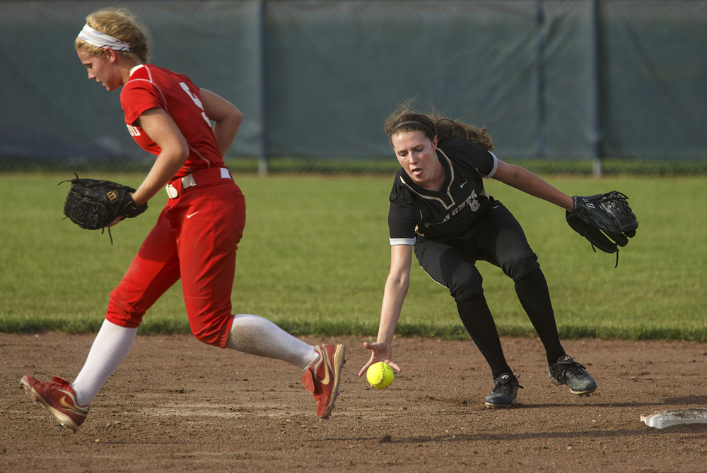 Sacred Heart-Griffin's Bree Derhake bare hands an infield grounder during the 2015 Land of Lincoln Softball Classic Monday, June 22, 2015. Ted Schurter/The State Journal-Register