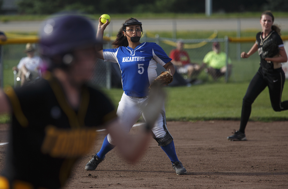 Decatur MacArthur's RiKiyah Harper throws to first base during the 2015 Land of Lincoln Softball Classic Monday, June 22, 2015. Ted Schurter/The State Journal-Register
