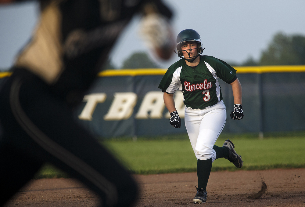 Lincoln's Brighton Robbins sprints for third base as a teammate heads for home during the 2015 Land of Lincoln Softball Classic Monday, June 22, 2015. Ted Schurter/The State Journal-Register