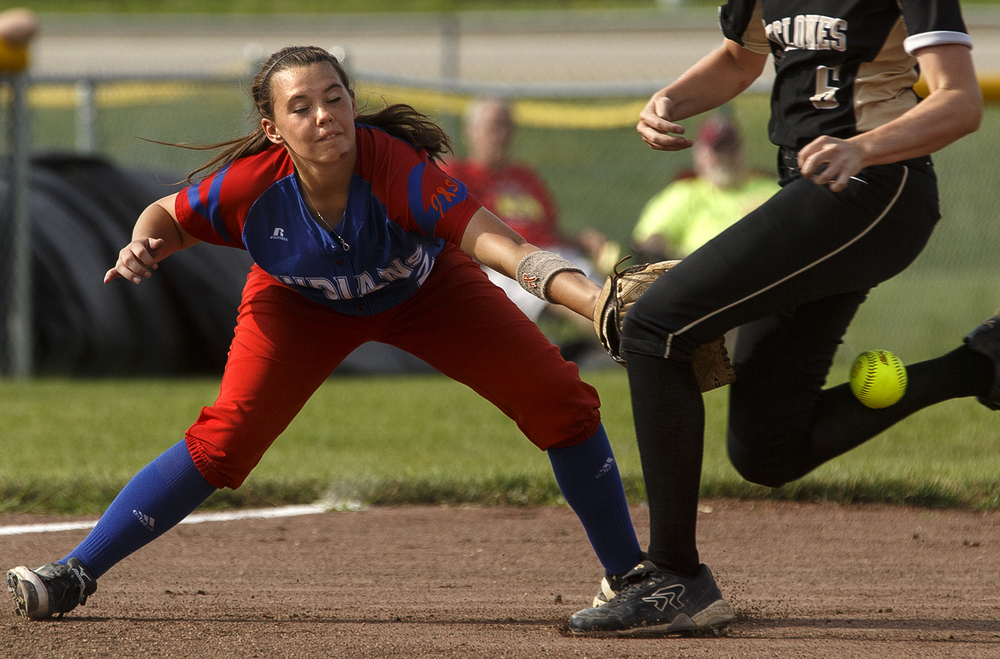 Pawnee's Kelsie Allen line to the ball is blocked by Sacred Heart-Griffin's Bree Derhake during the 2015 Land of Lincoln Softball Classic Monday, June 22, 2015. Ted Schurter/The State Journal-Register