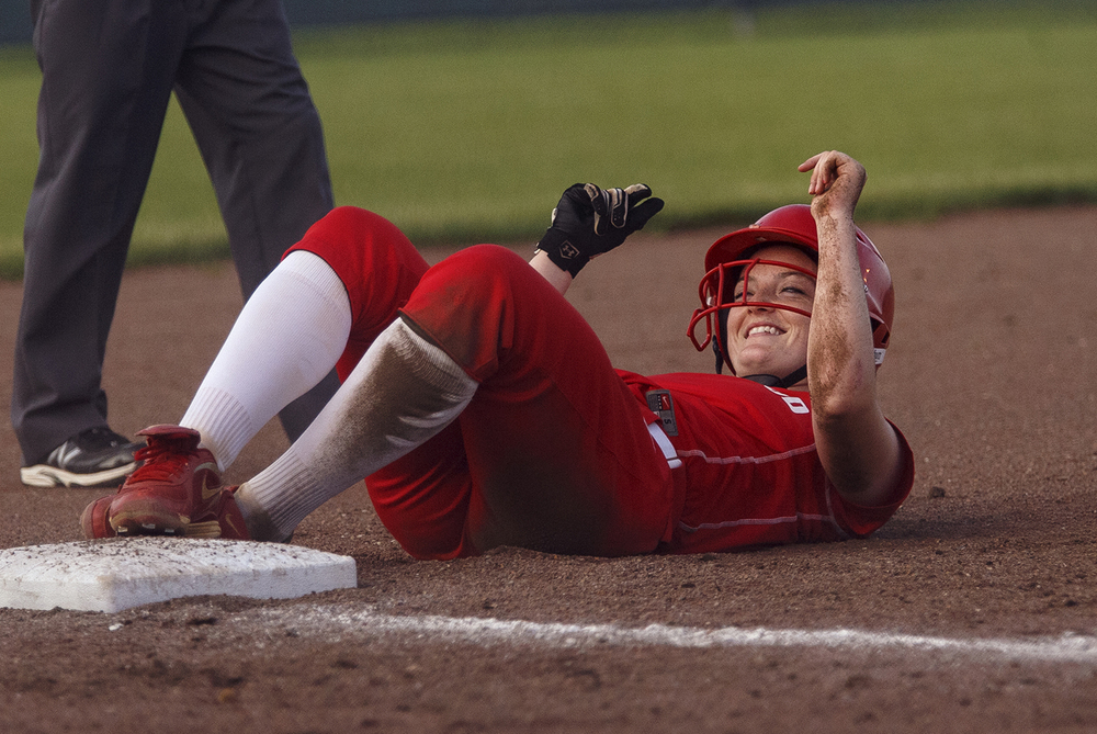 Glenwood's Catherine Ward is all smiles after getting tagged out on her slide into third base during the 2015 Land of Lincoln Softball Classic Monday, June 22, 2015. Ted Schurter/The State Journal-Register