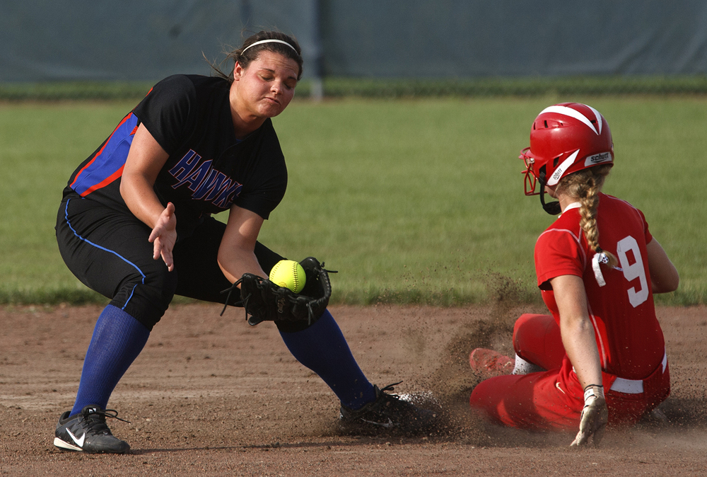 Riverton's Morgan Heckman can't hold onto the throw to second base and Glenwood's Sami Long slides to the bag during the 2015 Land of Lincoln Softball Classic Monday, June 22, 2015. Ted Schurter/The State Journal-Register