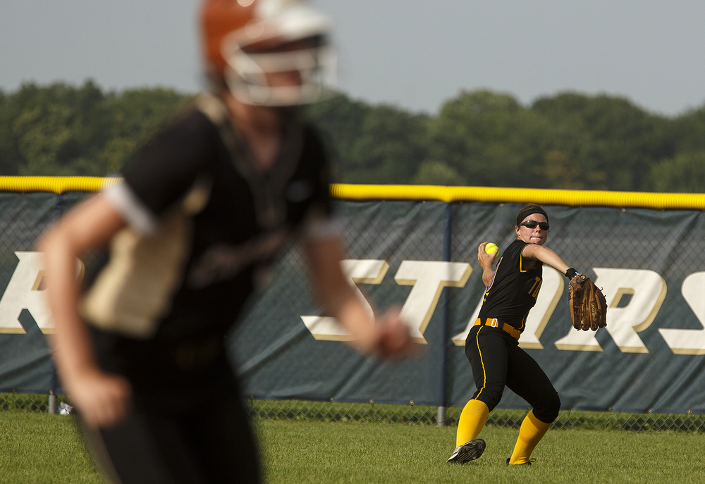 Taylorville's Kailey Talley holds a runner to first after fielding an outfield pop fly during the 2015 Land of Lincoln Softball Classic Monday, June 22, 2015. Ted Schurter/The State Journal-Register