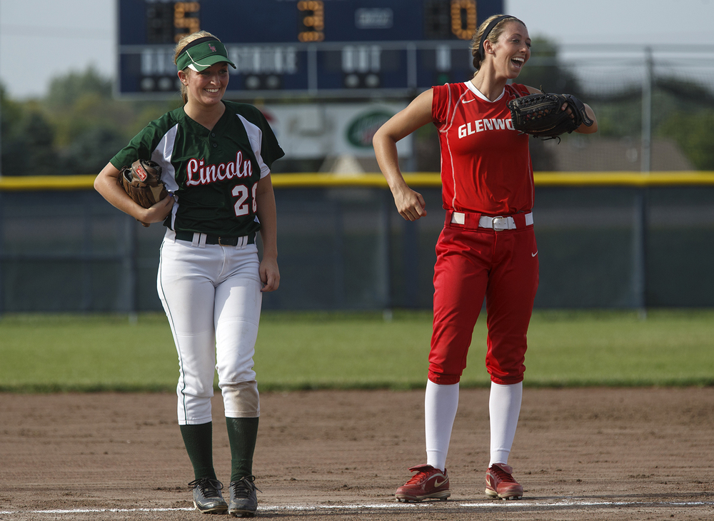 Lincoln's Madalyn Cooper and Glenwood's Parker Bnady laugh together during the 2015 Land of Lincoln Softball Classic Monday, June 22, 2015. Ted Schurter/The State Journal-Register