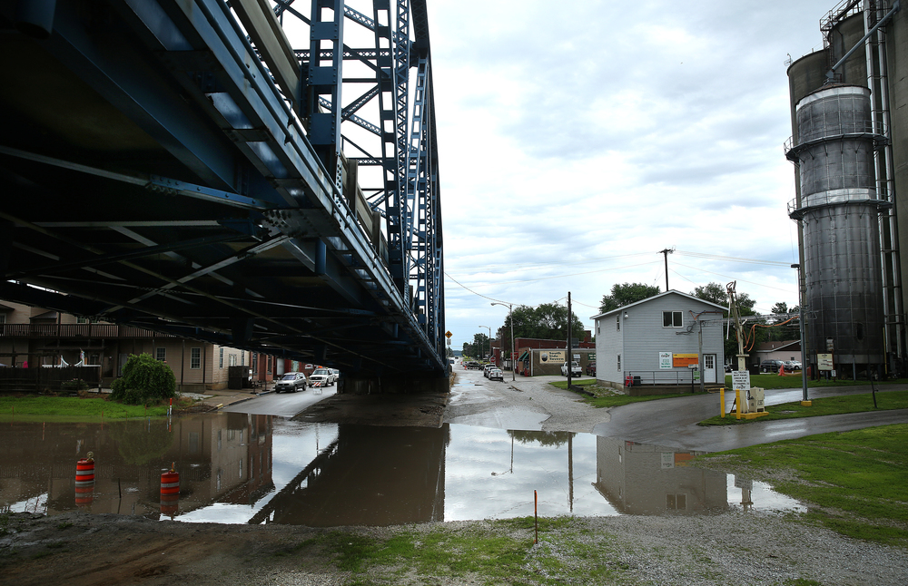Water from recent heavy rains collects on city streets underneath the superstructure of the steel-truss Meredosia River Bridge, first built in 1936 that is expected to be replaced by a new bridge by late 2018. David Spencer/The State Journal-Register